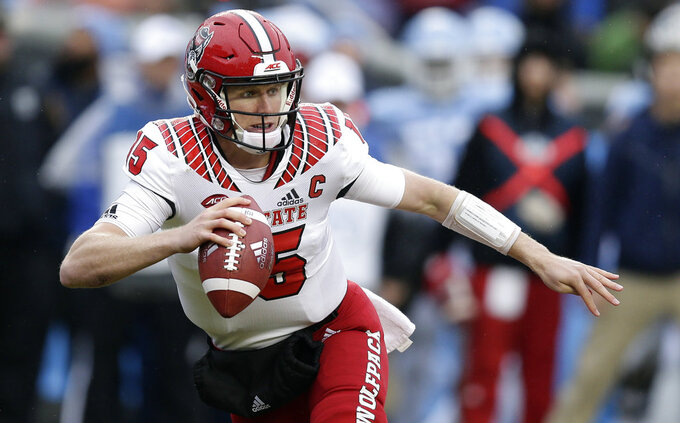 North Carolina State quarterback Ryan Finley (15) scrambles against North Carolina during the first half of an NCAA college football game in Chapel Hill, N.C., Saturday, Nov. 24, 2018. (AP Photo/Gerry Broome)