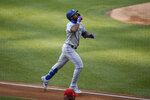 Toronto Blue Jays' Teoscar Hernandez reacts as he heads home while circling the bases after his home run during the first inning of a baseball game against the Washington Nationals, Monday, July 27, 2020, in Washington. (AP Photo/Nick Wass)