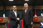 Turkey's President Recep Tayyip Erdogan, right, and Greece's Prime Minister Alexis Tsipras shake hands after their press conference at the Presidential Palace in Ankara, Tuesday, Feb. 5, 2019. Tsipras and Erdogan are set to discuss an array of subjects that have strained relations between the two NATO allies, including territorial disputes in the Aegean Sea and gas exploration in the eastern Mediterranean. (Presidential Press Service via AP, Pool)