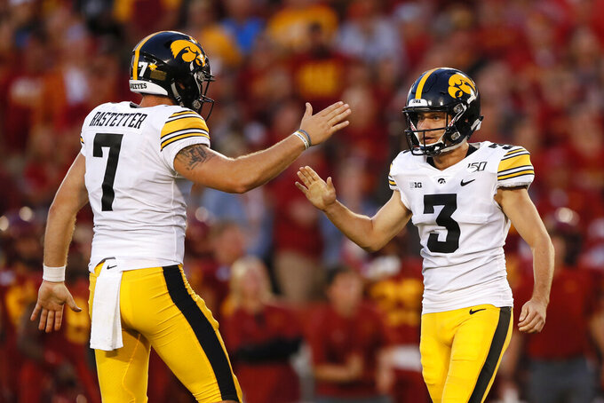 FILE - In this Sept. 14, 2019, file photo, Iowa's Keith Duncan (3) celebrates with Colten Rastetter, left, after kicking a field goal during the first half of an NCAA college football game against Iowa State, in Ames, Iowa. Duncan was a freshman hero _ only to lose his job for two full seasons. He's re-emerged as a key cog for the 14th-ranked Hawkeyes in 2019. (AP Photo/Charlie Neibergall, File)