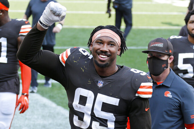 Cleveland Browns defensive end Myles Garrett celebrates after the Browns defeated the Washington Football Team in an NFL football game, Sunday, Sept. 27, 2020, in Cleveland. (AP Photo/Ron Schwane)