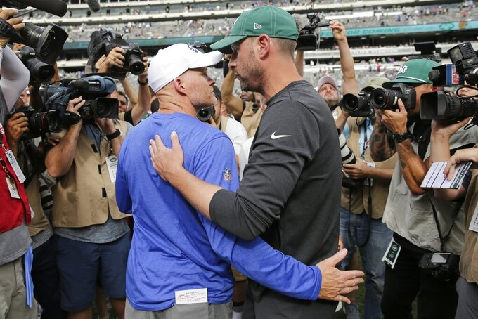 Buffalo Bills head coach Sean McDermott, left, greets New York Jets head coach Adam Gase after an NFL football game Sunday, Sept. 8, 2019, in East Rutherford, N.J. The Bills won 17-16. (AP Photo/Seth Wenig)