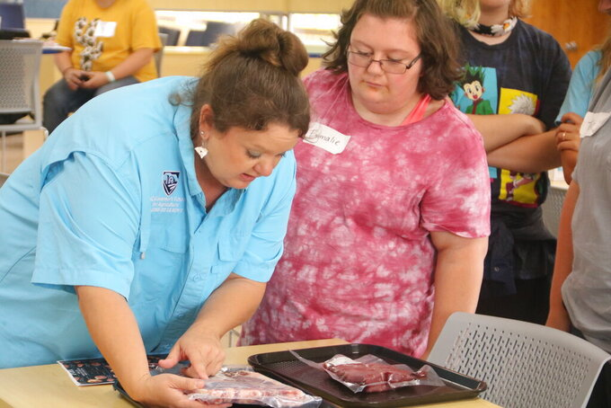 John de la Howe teacher Libby Templeton taught campers how to recognize different cuts of livestock on Monday afternoon. (Lindsey Hodges/The Index-Journal via AP)