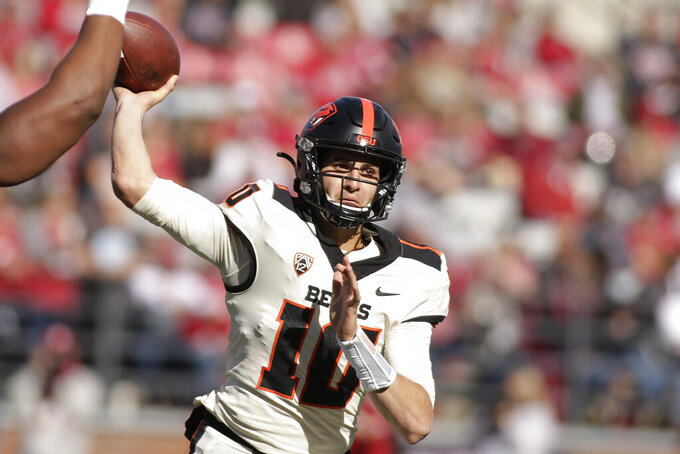 Oregon State quarterback Chance Nolan throws a pass during the first half of an NCAA college football game against Washington State, Saturday, Oct. 9, 2021, in Pullman, Wash. (AP Photo/Young Kwak)
