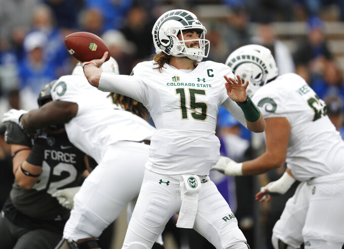 Colorado State quarterback Collin Hill throws a pass under pressure from Air Force defensive lineman Nakoa Pauloe in the first half of an NCAA college football game Thursday, Nov. 22, 2018, at Air Force Academy, Colo. (AP Photo/David Zalubowski)