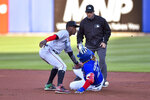 Toronto Blue Jays' Vladimir Guerrero Jr. slides safely into second for a double as Miami Marlins shortstop Jazz Chisholm Jr. (2) waits for the throw that bounced off Guerrero'a back during the first inning of a baseball game in Buffalo, N.Y., Tuesday, June 1, 2021. (AP Photo/Adrian Kraus)
