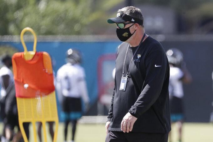 Jacksonville Jaguars head coach Doug Marrone watches players perform drills during an NFL football workout, Thursday, Aug. 13, 2020, in Jacksonville, Fla. (AP Photo/John Raoux)