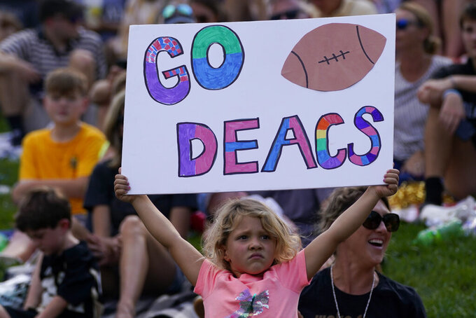 A sound fans holds up a sign during the second half of an NCAA college football game between Wake Forest and Louisville on Saturday, Oct. 2, 2021, in Winston-Salem, N.C. (AP Photo/Chris Carlson)