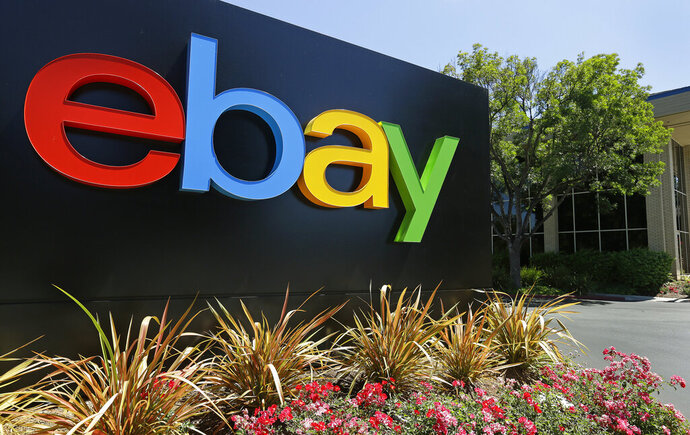 FILE - This Tuesday, July 16, 2013, file photo shows signage at eBay headquarters in San Jose, Calif.  EBay is initiating review concerning the future of its StubHub and its classified ads business. The e-commerce company said Friday, March 1, 2019 that there's no guarantee that the review will result in a sale, spin-off or other business combination involving its assets.   (AP Photo/Ben Margot, File)