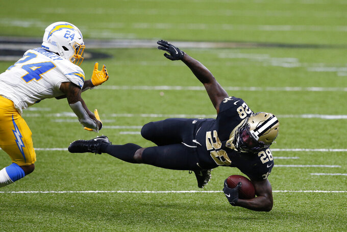 New Orleans Saints running back Latavius Murray (28) goes down against Los Angeles Chargers free safety Nasir Adderley (24) during overtime of an NFL football game in New Orleans, Monday, Oct. 12, 2020. (AP Photo/Butch Dill)