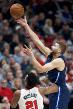 Dallas Mavericks forward Maxi Kleber, right, shoots over Portland Trail Blazers center Hassan Whiteside during the first half of an NBA basketball game in Portland, Ore., Thursday, Jan. 23, 2020. (AP Photo/Craig Mitchelldyer)