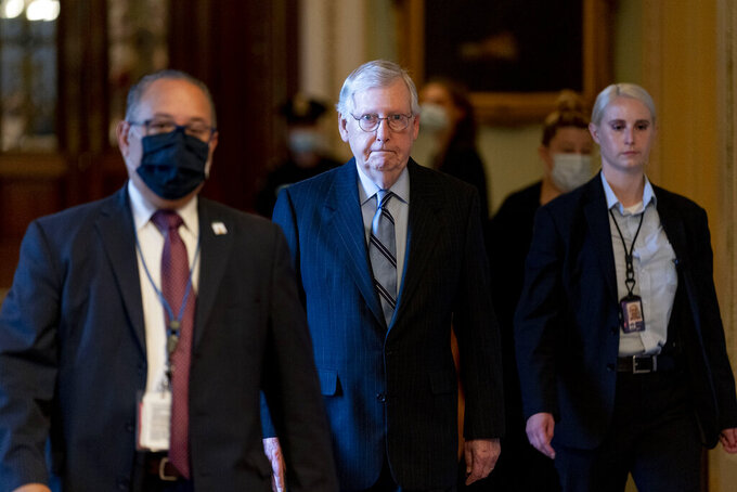 Senate Minority Leader Mitch McConnell of Ky. arrives as the $1 trillion bipartisan infrastructure package is expected to be voted on by the Senate this morning on Capitol Hill in Washington, Tuesday, Aug. 10, 2021. (AP Photo/Andrew Harnik)
