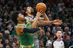 Brooklyn Nets guard Spencer Dinwiddie is fouled by Boston Celtics guard Marcus Smart (36) during the first half of an NBA basketball game Tuesday, March 3, 2020, in Boston. (AP Photo/Mary Schwalm)