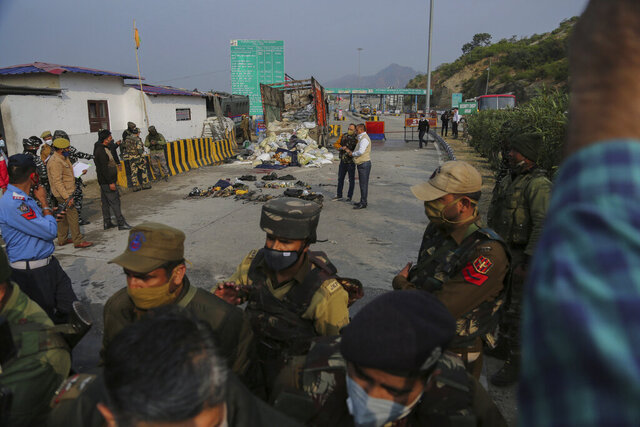 Indian security forces inspect the site after a gunfight between suspected rebels and Indian security forces at a checkpoint in Nagrota, outskirts of Jammu, India, Thursday, Nov.19, 2020. Four suspected militants were killed and two Indian police officers were wounded in the gunfight on the main highway linking Jammu and Srinagar police said. (AP Photo/Channi Anand)