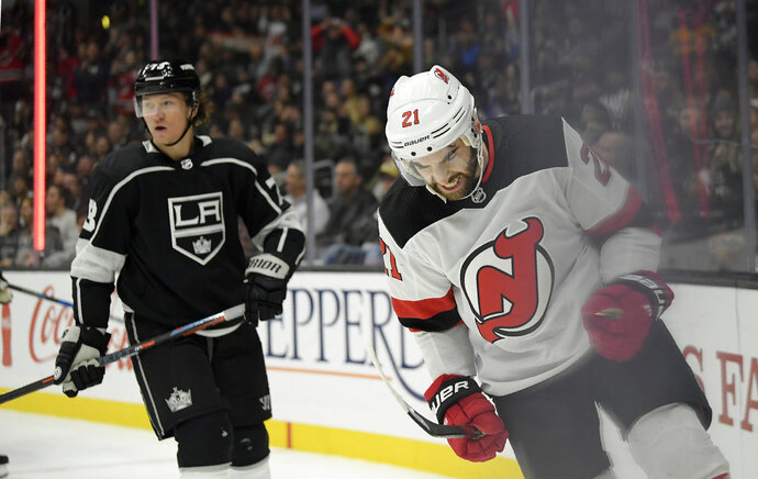 New Jersey Devils right wing Kyle Palmieri, right, celebrates his goal as Los Angeles Kings right wing Tyler Toffoli skates in the background during the first period of an NHL hockey game Thursday, Dec. 6, 2018, in Los Angeles. (AP Photo/Mark J. Terrill)