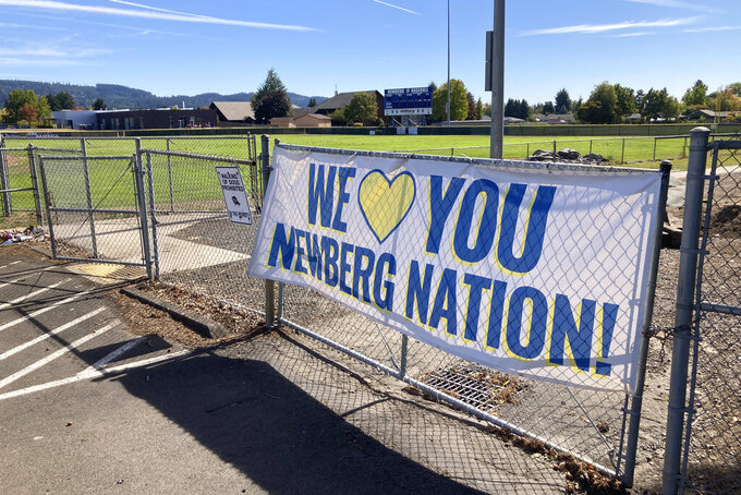 A banner thanking supporters of Newberg schools is seen on Tuesday, Sept. 21, 2021, next to the athletic fields of Newberg High School, in Newberg, Ore. The Newberg School Board has banned educators from displaying Black Lives Matter and gay pride symbols, prompting a torrent of recriminations and threats to boycott the town and its businesses. (AP Photo/Andrew Selsky)