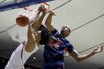Arizona guard Josh Green, left, dunks next to Pepperdine center Victor Ohia Obioha during the first half of an NCAA college basketball game at the Wooden Legacy tournament in Anaheim, Calif., Thursday, Nov. 28, 2019. (AP Photo/Alex Gallardo)