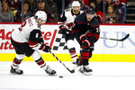 Carolina Hurricanes' Andrei Svechnikov (37), of Russia, battles Arizona Coyotes' Nick Schmaltz (8) for the puck during the second period of an NHL hockey game in Raleigh, N.C., Friday, Jan. 10, 2020. (AP Photo/Karl B DeBlaker)