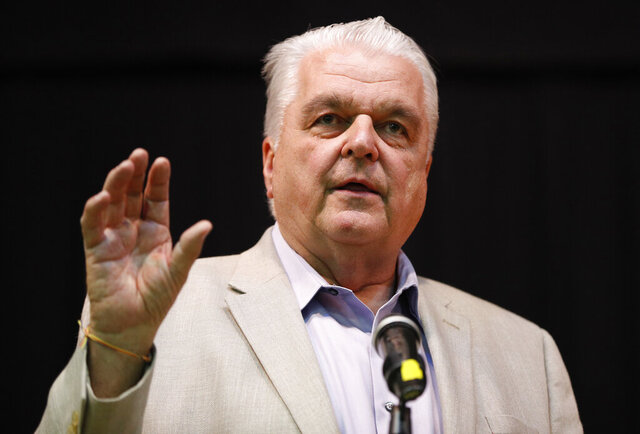 FILE - In this May 8, 2018, file photo, then-Clark County Commission member Steve Sisolak speaks during a forum for Nevada gubernatorial candidates organized by Nevada faith groups in Las Vegas. Democratic Gov. Steve Sisolak released a budget proposal for the upcoming two years that includes steep cuts to education and increased spending on health care. Sisolak and his staff said better-than-expected revenue projections and federal relief allowed the state to avoid proposing more severe cuts anticipated earlier in 2020. (AP Photo/John Locher, File)