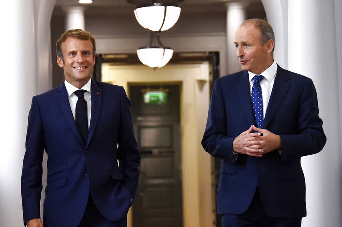 French President Emmanuel Macron, left, walks with Ireland's Prime Minister Micheal Martin in Dublin, Ireland, Thursday, Aug. 26, 2021. French President Emmanuel Macron is on Thursday on his first visit to Ireland, where talks are expected to focus on the situation in Afghanistan and European issues. (Clodagh Kilcoyne/Pool Photo via AP)