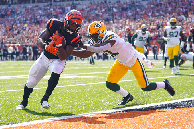 Cincinnati Bengals running back Samaje Perine (34) runs in for a touchdown in front of Green Bay Packers safety Adrian Amos (31) in the first half of an NFL football game in Cincinnati, Sunday, Oct. 10, 2021. (AP Photo/Bryan Woolston)