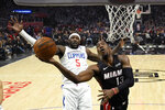 Miami Heat forward Bam Adebayo, right, shoots as Los Angeles Clippers forward Montrezl Harrell defends during the first half of an NBA basketball game Wednesday, Feb. 5, 2020, in Los Angeles. (AP Photo/Mark J. Terrill)