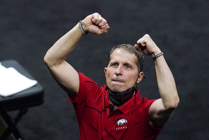 Arkansas head coach Eric Musselman reacts to fans following a first round game against Colgate at Bankers Life Fieldhouse in the NCAA men's college basketball tournament, Friday, March 19, 2021, in Indianapolis. Arkansas defeated Colgate 85-68. (AP Photo/Darron Cummings)