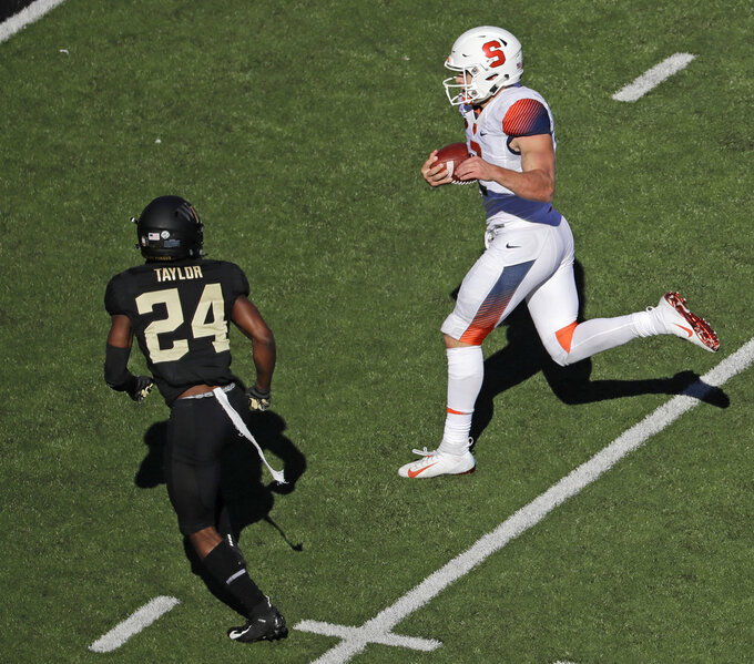 Syracuse's Eric Dungey (2) runs for a touchdown past Wake Forest's Ja'Sir Taylor (24) in the second half of an NCAA college football game in Charlotte, N.C., Saturday, Nov. 3, 2018. (AP Photo/Chuck Burton)