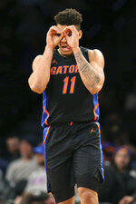 Florida forward Keyontae Johnson (11) reacts after scoring during the second half of an NCAA college basketball game against Providence at Barclays Center, Tuesday, Dec. 17, 2019, in New York. Florida won, 83-51. (AP Photo/Michael Owens)