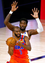 Oklahoma City Thunder's Chris Paul (3) is pressured by Phoenix Suns' Deandre Ayton during the third quarter of an NBA basketball game Monday, Aug. 10, 2020, in Lake Buena Vista, Fla. (Mike Ehrmann/Pool Photo via AP)