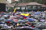 Anti-government protesters rally during a nationwide strike, at Bolivar square in downtown Bogota, Colombia, Thursday, Nov. 21, 2019. Colombia's main union groups and student activists called for a strike to protest the economic policies of Colombian President Ivan Duque government and a long list of grievances. (AP Photo/Fernando Vergara)