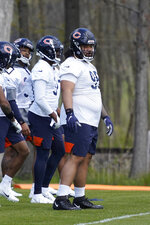 Chicago Bears nose tackle Khyiris Tonga (95) waits to do a drill during the NFL football team's rookie minicamp Friday, May, 14, 2021, in Lake Forest Ill. (AP Photo/David Banks, Pool)