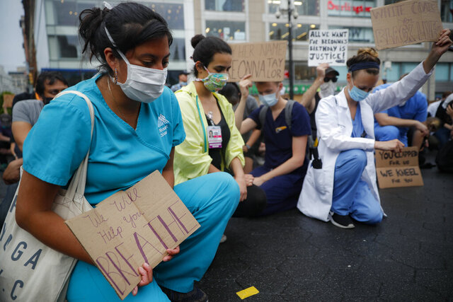 Medical professionals join a protest rally at Union Square, Friday, June 5, 2020, in the Manhattan borough of New York. Protests continued following the death of George Floyd, who died after being restrained by Minneapolis police officers on May 25. (AP Photo/John Minchillo)