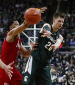 Michigan State guard Matt McQuaid (20) passes as Nebraska guard James Palmer Jr. defends during the second half of an NCAA college basketball game, Tuesday, March 5, 2019, in East Lansing, Mich. (AP Photo/Carlos Osorio)
