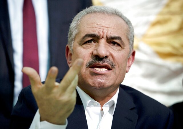 FILE - In this Wednesday, Jun. 24, 2020 file photo, Palestinian Prime Minister Mohammad Shtayyeh speaks during the leadership meeting at the village of Fasayil in Jordan Valley. The Palestinian prime minister has said it will be disastrous for his people and the world at large if President Donald Trump wins re-election next month. (AP Photo/Majdi Mohammed, File)