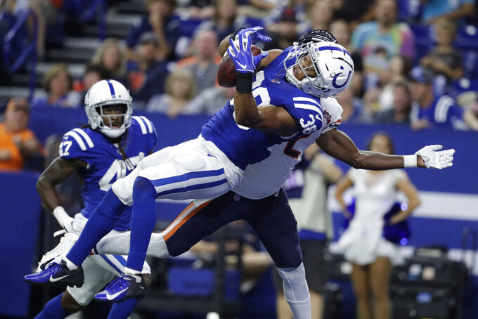 Indianapolis Colts defensive back Isaiah Johnson (38) makes an interception next to Chicago Bears wide receiver Joe Walker (2) during the second half of an NFL preseason football game, Saturday, Aug. 24, 2019, in Indianapolis. (AP Photo/Michael Conroy)