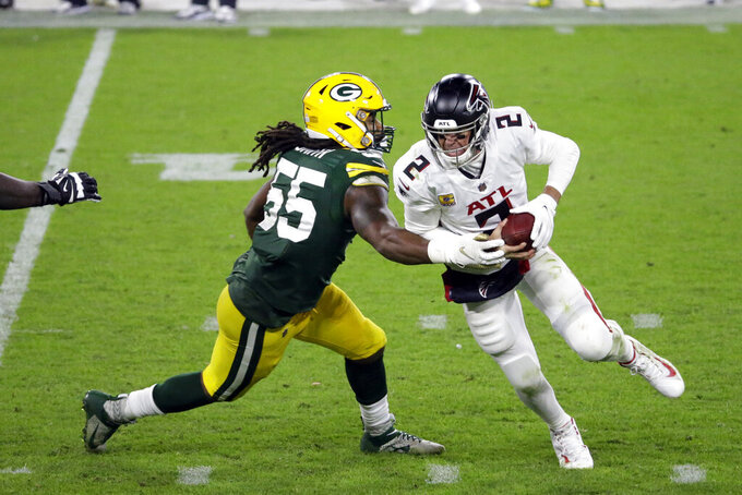 Atlanta Falcons quarterback Matt Ryan (2) is sacked by Green Bay Packers' Za'Darius Smith (55) during the second half of an NFL football game, Monday, Oct. 5, 2020, in Green Bay, Wis. (AP Photo/Mike Roemer)