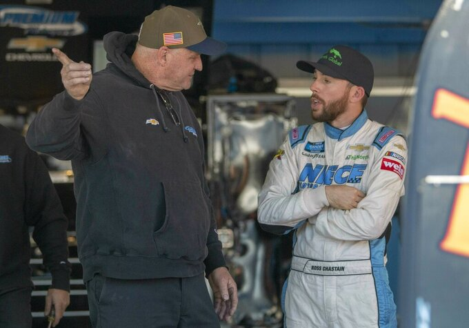 Ross Chastain talks with a crew member during practice for the NASCAR Monster Energy Cup Series race at Martinsville Speedway in Martinsville, Va., Saturday, March 23, 2019. (AP Photo/Matt Bell)