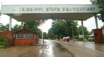 FILE - This is a July 12, 2002 file photo of the entrance to the Mississippi State Penitentiary at Parchman, Miss. The Justice Department has opened a civil rights investigation into the Mississippi prison system after a string of inmate deaths in the past few months, officials said Wednesday, Feb. 5, 2020. (AP Photo/Rogelio Solis, File)