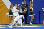 Eastern Michigan wide receiver Quian Williams reacts after a 50-yard touchdown during the first half of the Quick Lane Bowl NCAA college football game against Pittsburgh, Thursday, Dec. 26, 2019, in Detroit. (AP Photo/Carlos Osorio)