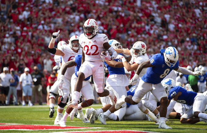 Nebraska's Gabe Ervin Jr. (22) leaps into the end zone for a touchdown ahead of Buffalo's James Patterson (8) during the first half of an NCAA college football game, Saturday, Sept. 11, 2021, at Memorial Stadium in Lincoln, Neb. (AP Photo/Rebecca S. Gratz)