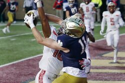 Notre Dame wide receiver Ben Skowronek (11) makes a touchdown reception against Boston College defensive back Brandon Sebastian (10) during the first half of an NCAA college football game, Saturday, Nov. 14, 2020, in Boston. (AP Photo/Michael Dwyer)