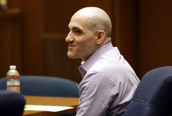 FILE - In this Wednesday, Aug. 7, 2019 file photo, Michael Gargiulo smiles as his attorney presents closing arguments during his trial in Los Angeles. A Los Angeles jury on Thursday, Aug. 22, 2019, determined that Gargiulo was sane when he fatally stabbed two women and tried to kill a third inside their Southern California homes. Jurors will now be asked to determine Gargiulo's fate at a penalty phase that is scheduled to begin on Sept. 9. (AP Photo/Marcio Jose Sanchez, Pool, File)