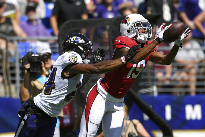 Arizona Cardinals wide receiver KeeSean Johnson, right, catches a pass in front of Baltimore Ravens cornerback Brandon Carr in the first half of an NFL football game, Sunday, Sept. 15, 2019, in Baltimore. (AP Photo/Nick Wass)