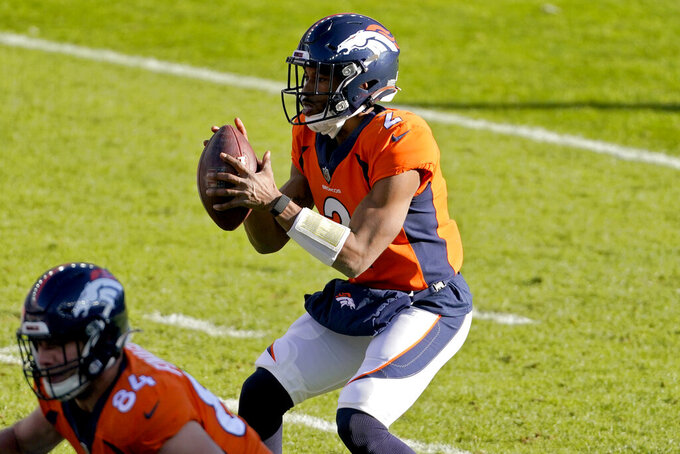 Denver Broncos quarterback Kendall Hinton (2) takes the snap during the first half of an NFL football game against the New Orleans Saints, Sunday, Nov. 29, 2020, in Denver. (AP Photo/Jack Dempsey)
