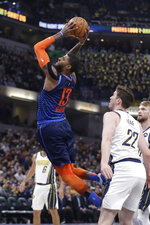 Oklahoma City Thunder's Paul George (13) goes up for a dunk against Indiana Pacers' T.J. Leaf (22) during the first half of an NBA basketball game, Thursday, March 14, 2019, in Indianapolis. (AP Photo/Darron Cummings)