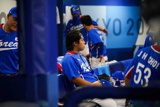 South Korea's Baekho Kang sits on the bench after a semi-final baseball game against the United States at the 2020 Summer Olympics, Thursday, Aug. 5, 2021, in Yokohama, Japan. The United States won 7-2. (AP Photo/Sue Ogrocki)