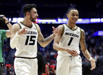 Missouri's Jordan Geist (15) and Xavier Pinson (1) leave the court after beating Georgia in an NCAA college basketball game at the Southeastern Conference tournament, Wednesday, March 13, 2019, in Nashville, Tenn. Missouri won 71-61. (AP Photo/Mark Humphrey)