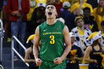 Oregon guard Payton Pritchard celebrates a basket against Michigan during the overtime of an NCAA college basketball game in Ann Arbor, Mich., Saturday, Dec. 14, 2019. Oregon won 71-70 in overtime. (AP Photo/Paul Sancya)