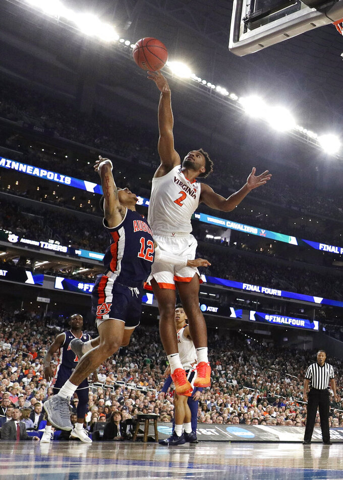 Virginia guard Braxton Key (2) blocks a shot by Auburn guard J'Von McCormick during the first half in the semifinals of the Final Four NCAA college basketball tournament, Saturday, April 6, 2019, in Minneapolis. (AP Photo/David J. Phillip)